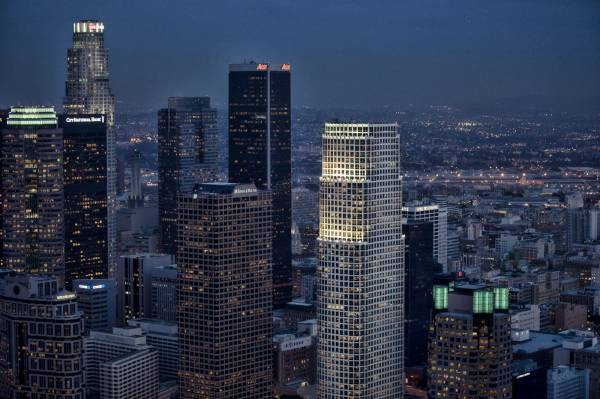 Downtown skyline at night by helicopter